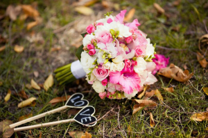 Colorful wedding bouquet with roses and gladiolus on the grass