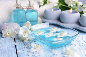 Spa composition with jasmine flowers on table close-up