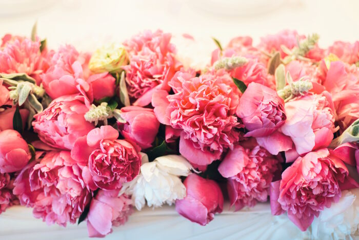 Peony flower meaning flower meaning floral arrangement of pink peonies with leaves mightylinksfo